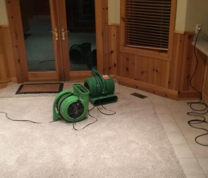 air movers in a carpeted area of a home